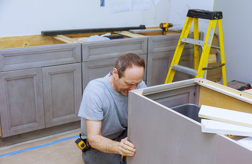 Improvement contractor installing new custom kitchen cabinet furniture decoration cabinets